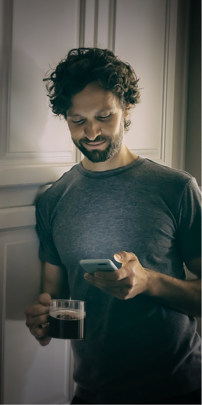 Man using the Somryst™ app on his phone